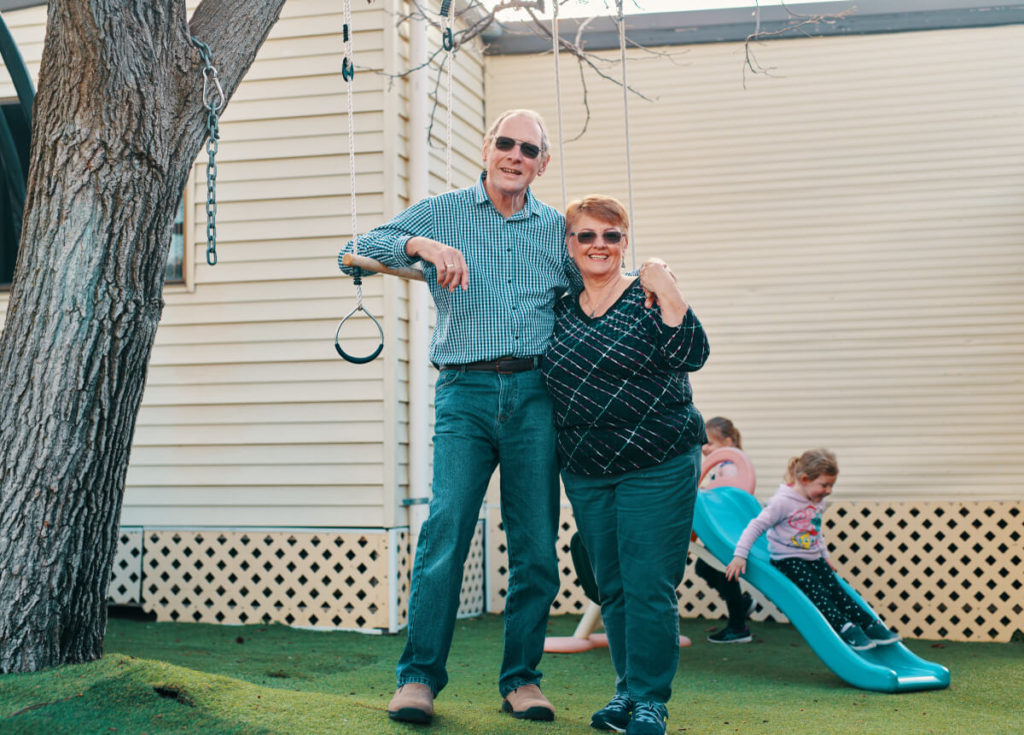 grandparents with grandkids playing in garden